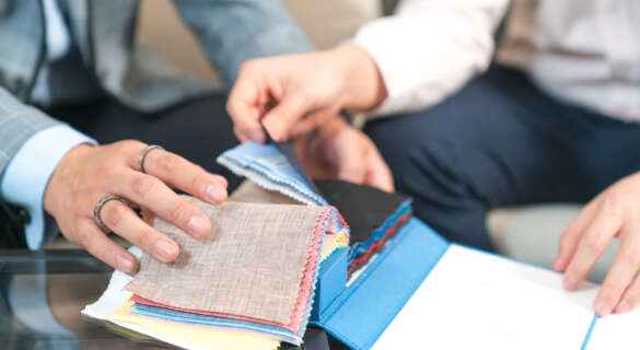 Male tailor choosing fabric